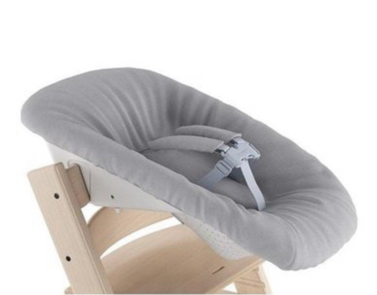 Grey Nest-like high chair for newborns